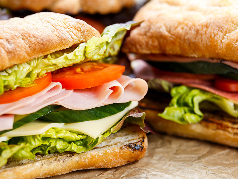 Fresh sub sandwich with turkey and tomatoes with lettuce