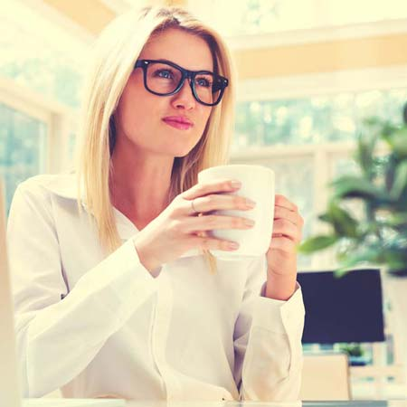 employee drinking a cup of coffee